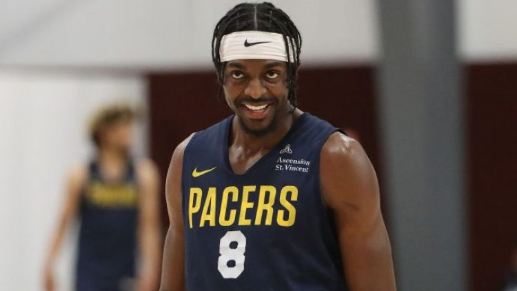 Indiana re-signs wing Justin Holiday on three-year deal