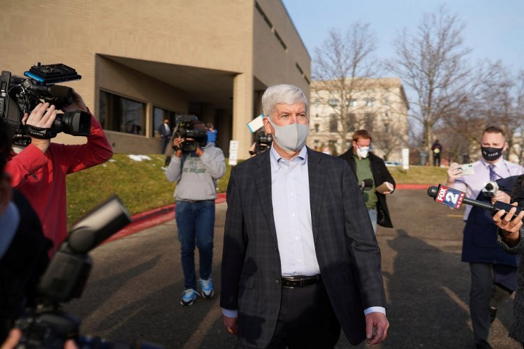 Nine charged in Flint water fiasco, ex-Gov. Snyder pleads not guilty